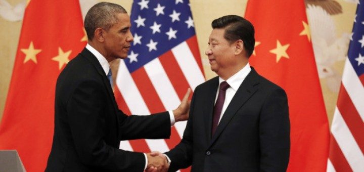 U.S. President Barack Obama and Chinese President Xi Jinping shake hands at the end of their news conference in the Great Hall of the People in Beijing