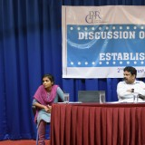 A Alexander (Additional Labour Commissioner, Kerala) addressing the participants, (sitting from left) Sara John (Project Associate, CPPR), S N Raghuchandran Nair (President, TCCI) and Arun (Deputy Labour Commissioner, Kerala)