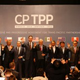 Members of Trans-Pacific Partnership trade deal pose for an official picture after the signing agreement ceremony in Santiago